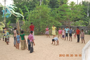 Mr P Santosh, yoga trainer, teaching the children.