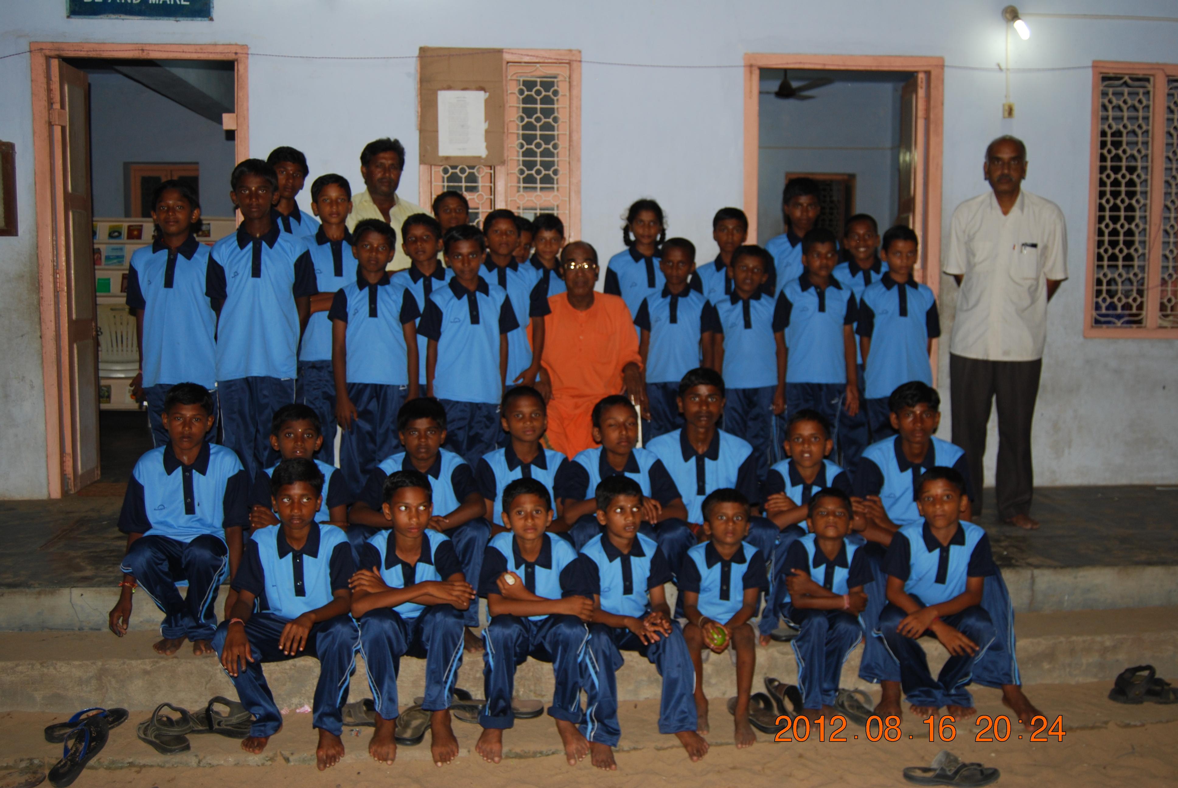 Some of the children with dresses for doing yoga asanas with Rev. Swami Aksharatmanandaji Maharaj.