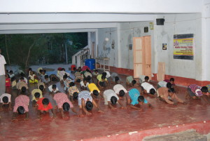 Children doing yoga in the evening.