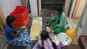 Trying their hand at making chapatis