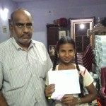 One child, Shahina wins a prize at school