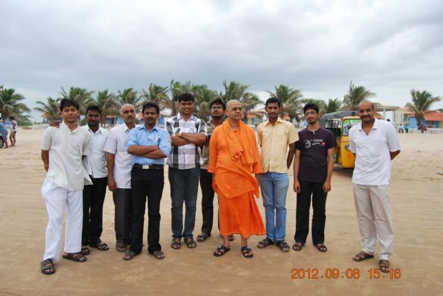 Rev. Swami Atmashraddhanandaji Maharaj at Suryalanka Beach with youth members.