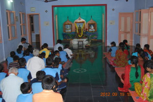 Devotees and children gathered