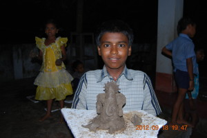 One of the child with the image he/she made.