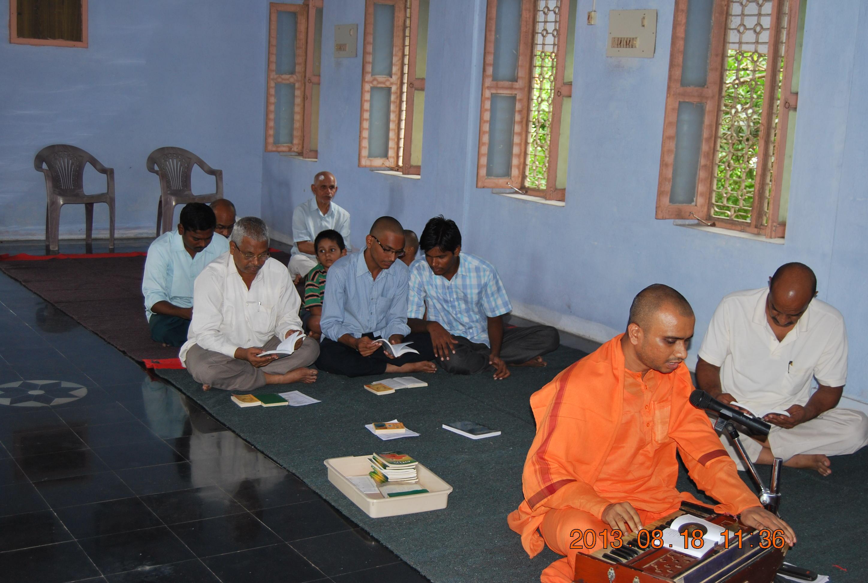 Rev. Swami Purnabodhanandaji Maharaj singing kirtan.