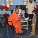 Rev. Swami Paramasukhanandaji Maharaj interacting with a kid