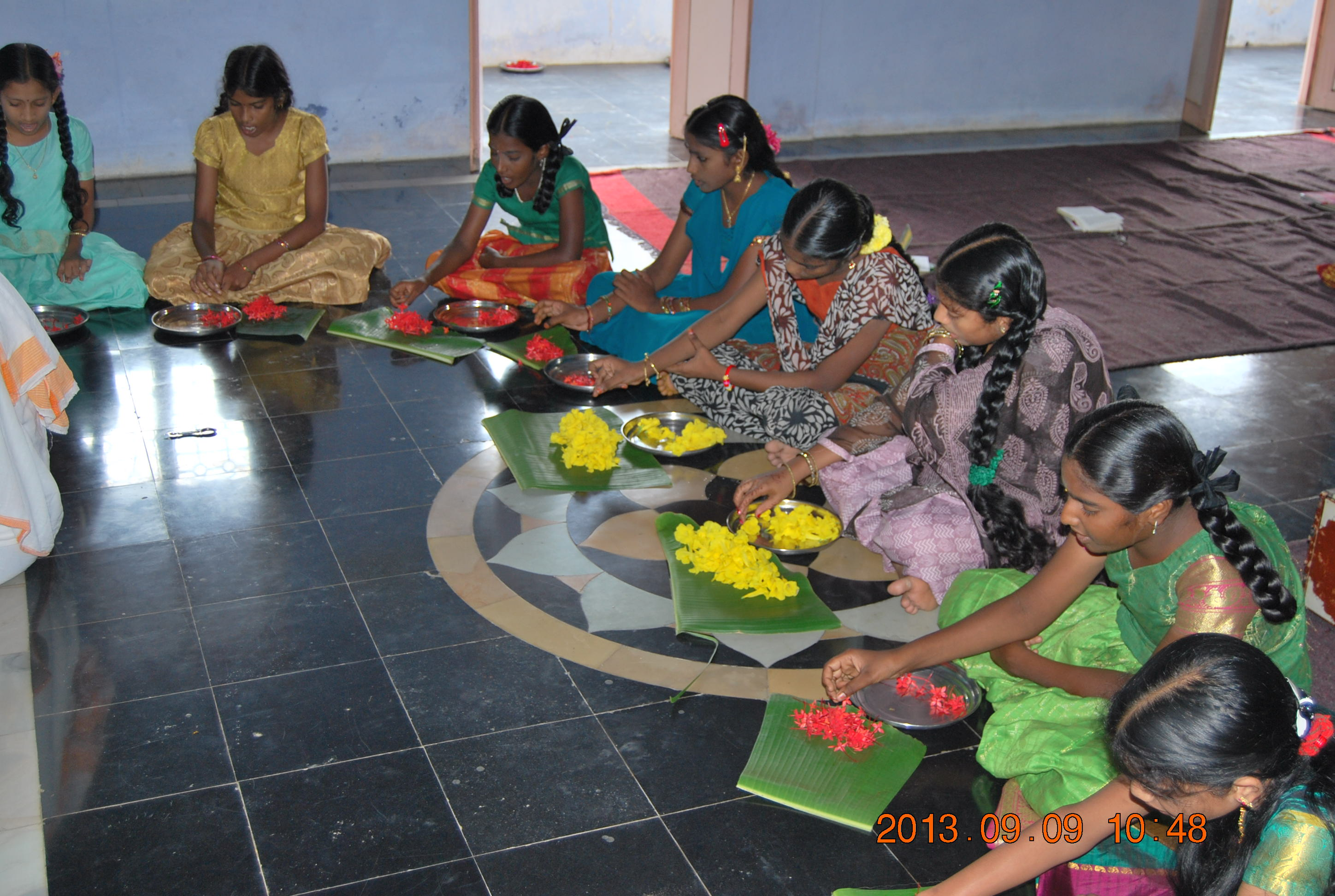 Children joing the puja