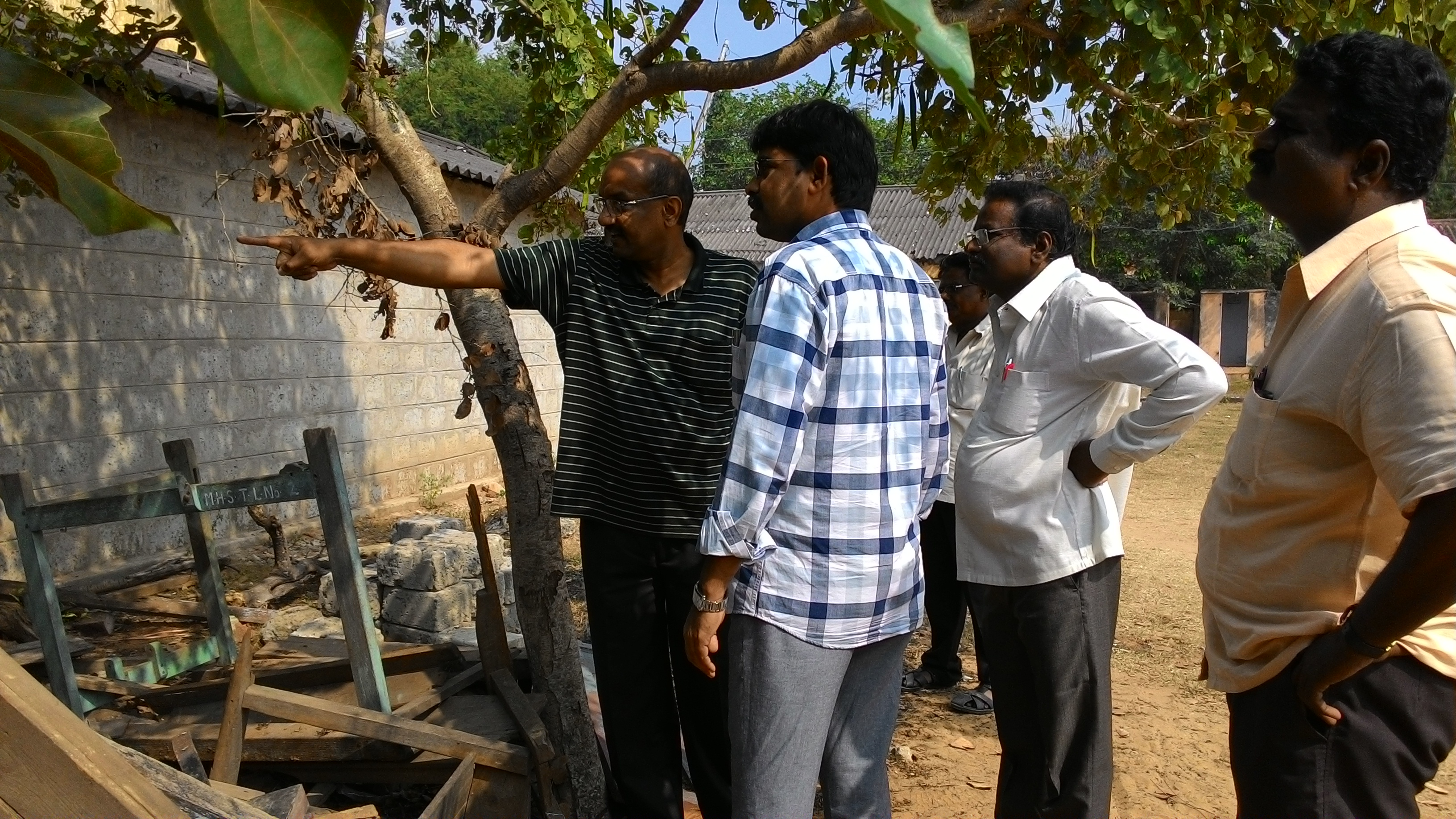 Inspecting the old benches with the Municipal Commissioner