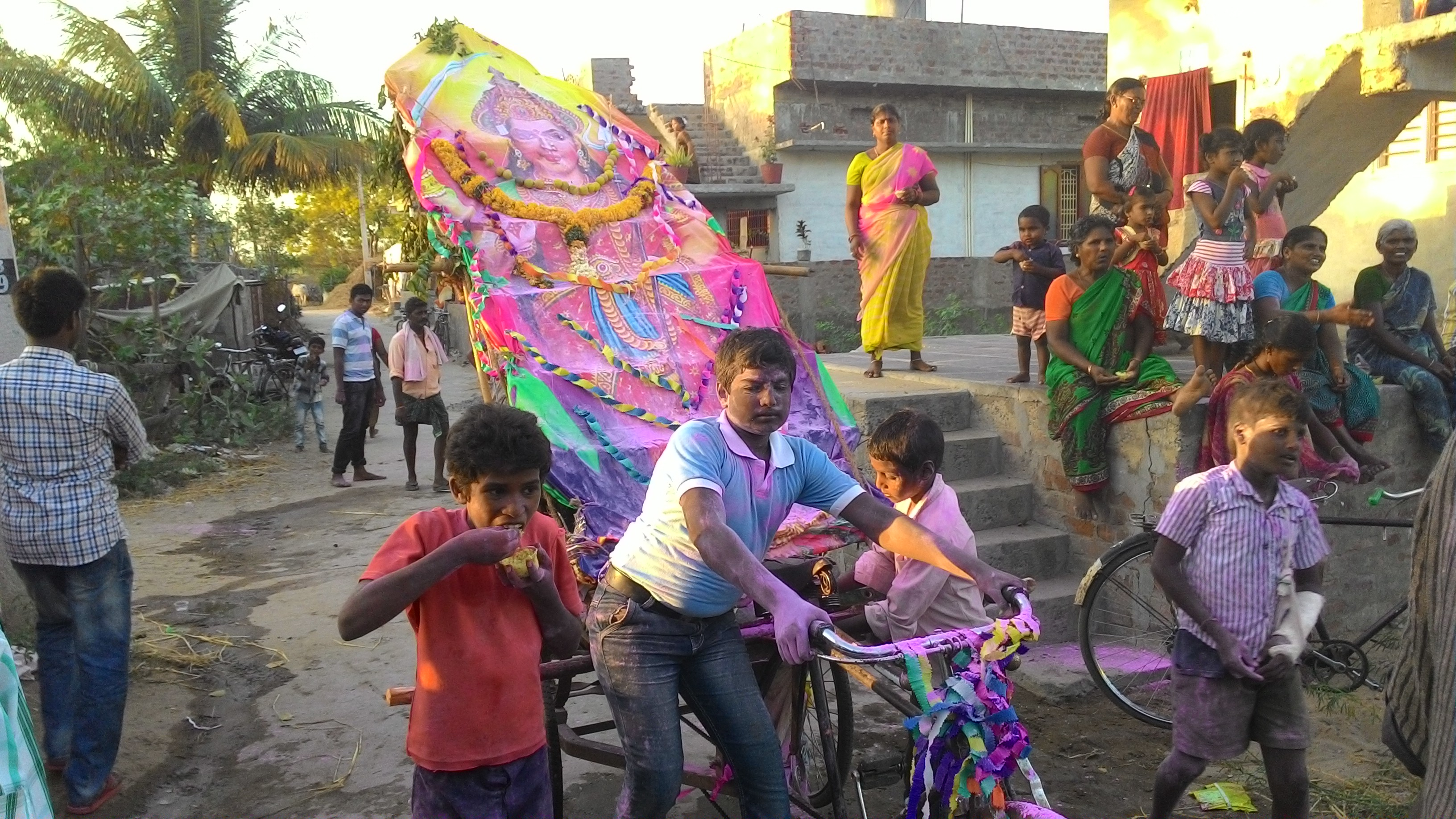 Some enthusiastic youngsters who prepared a second prabha and taking it on a rickshaw