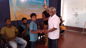 Prize distribution. Sri Khadar Vali giving away prizes.