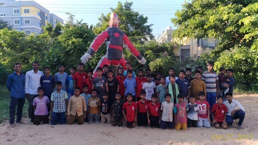 Kids with Narakasura Statue